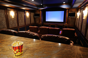 luxury custom home theater with wall lighting sconce's, custome theater seating and projection screen