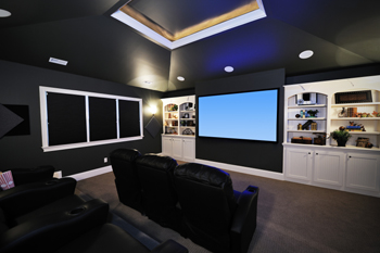contemporary home theater with two rows of custom theater seating