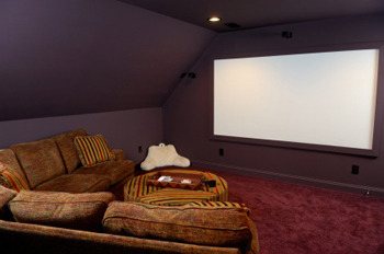 home entertainment  theater in bonus room with sectional and projection screen on wall