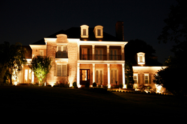 large estate at night with dramatic lighting